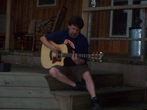 Jeff playing his guitar at the Cove